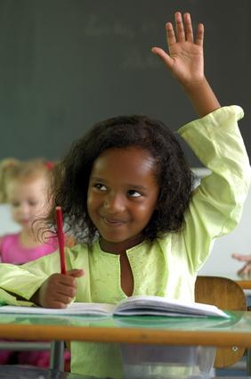a girl raising hand
