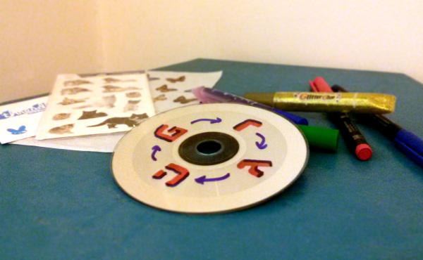 a cd and markers