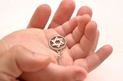a hand holding a star of david