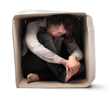 a man inside a cardboard box
