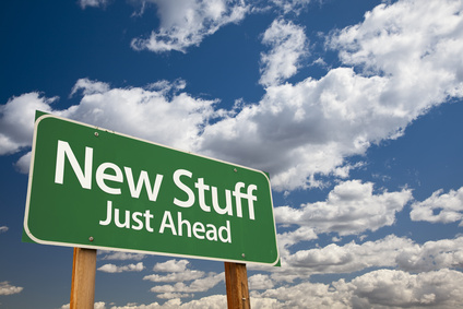 a road sign says 'new stuff'