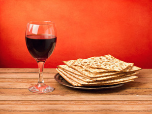 a glass of wine and matzohs
