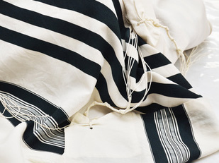 a tallit (prayer shawl)